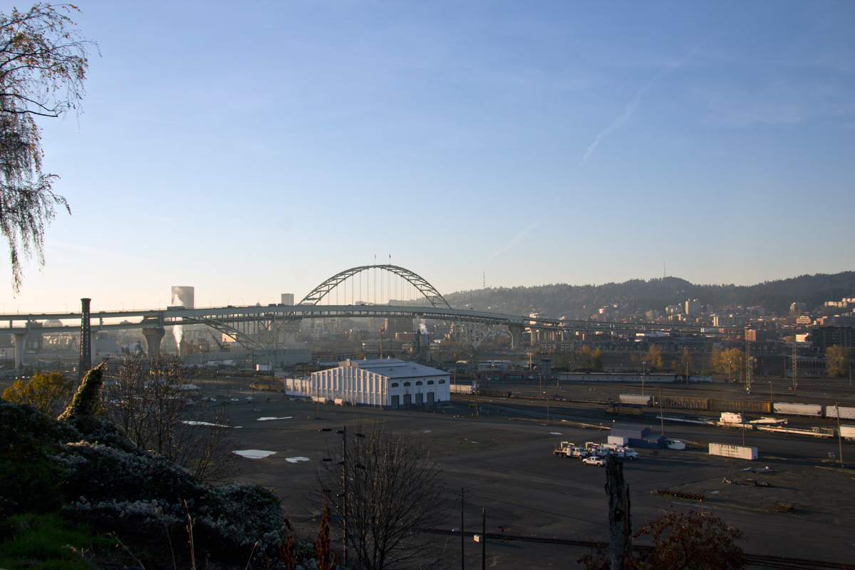 Portland, OR: Union Pacific Albinas Yard with Fremont Bridge and downtown in the background (early morning).